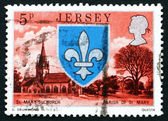 Postage stamp Guernsey 1976 Arms and St. Mary Church — Stock Photo