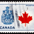 Stock Photo: Postage stamp Canada 1966 Maple Leaf and Arms of Canada