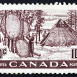 Stock Photo: Postage stamp Canad1950 Indians Drying Skins on Stretchers