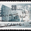 Postage stamp Canad1952 Symbols of Newsprint Paper Production — Stock Photo #15711895
