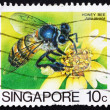 Stock Photo: Postage stamp Singapore 1985 Honey Bee Collecting Nectar