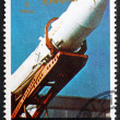 Stock Photo: Postage stamp Umm al-Quwain 1972 Soviet Rocket being Erected