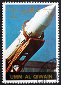 Postage stamp Umm al-Quwain 1972 Soviet Rocket being Erected — Stock Photo