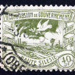Postage stamp GDR 1920 Dove Flying over Silesian Terrain - Stock Photo