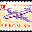 图库照片: Postage stamp Romani1963 Plane over City