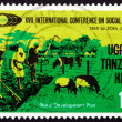 Postage stamp Tanzania, Kenya, Uganda 1974 Family Hoeing - Stock Photo