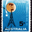 Foto de Stock  : Postage stamp Australia 1965 Radio Mast and Satellite Orbiting E