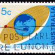 Foto de Stock  : Postage stamp Australia 1968 Satellite Orbiting Earth