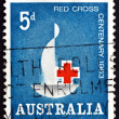Stock Photo: Postage stamp Australi1963 Red Cross Centenary Emblem