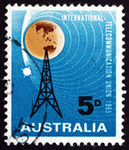Postage stamp Australia 1965 Radio Mast and Satellite Orbiting E — Stock Photo