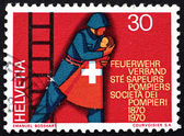Postage stamp Switzerland 1970 Fireman Rescuing Child — Stock Photo