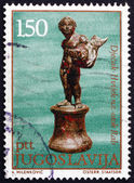 Postage stamp Yugoslavia 1971 Boy with Fish, Antique Bronze — Stock Photo