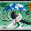图库照片: Postage stamp GB 1983 Birds under umbrella