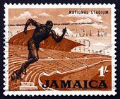 Postage stamp Jamaica 1964 Stadium and Statue of Runner — Stock Photo