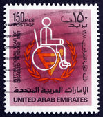 Postage stamp UAE 1981 Man in Wheelchair — Stock Photo