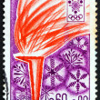 Postage stamp France 1968 Olympic Flame and Snowflakes - Stock Photo