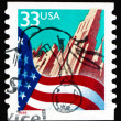 Royalty-Free Stock Photo: Postage stamp USA 1999 Flag and City