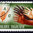 Stock Photo: Postage stamp Togo 1963 Hands Reaching for FAO Emblem