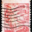 Postage stamp Cuba 1948 Liberty Carrying Flag and Cigars — Stock Photo
