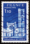 Postage stamp France 1976 shows Lodeve Cathedral, Herault — Stock Photo