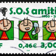 Stock Photo: Postage stamp France 2000 S.O.S. Amitie, 40th Anniversary