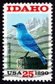 Postage stamp USA 1990 Mountain Bluebird and Sawtooth Mountains — Stock Photo