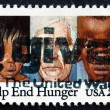 Stock Photo: Postage stamp US1982 Youths and Elderly Suffering from Malnutr
