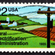 图库照片: Postage stamp US1985 Electrified Farm