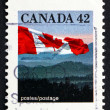 Postage stamp Canada 1991 Canadian Flag and Hills — Stock Photo
