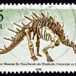Stock Photo: Postage stamp GDR 1990 Kentrurosaurus, Dinosaur, Extinct Animal