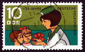 Postage stamp GDR 1970 Young Pioneers Congratulating Police Woma — Stock Photo