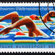 图库照片: Postage stamp Germany 1978 Swimmers