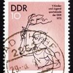 Постер, плакат: Postage stamp GDR 1975 Torch Bearer