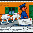 Stock Photo: Postage stamp France 1997 Following Postman, Letter