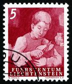 Postage stamp Liechtenstein 1951 Boy Cutting Bread — 图库照片