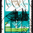 Stock Photo: Postage stamp GDR 1974 Freighter and Paddle Steamer
