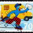 Stock Photo: Postage stamp Switzerland 1997 Globi as Postman