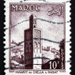 Stock Photo: Postage stamp Morocco 1955 Minaret de Chellah, Rabat