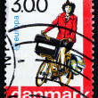 Postage stamp Denmark 1988 Postwoman on Bicycle — Stock Photo #40976111