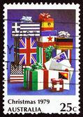 Estampilla australia 1979 cartas y paquetes envueltos en bandera — Foto de Stock