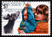 Postage stamp Australia 1987 Playing with a Joey, Children — Foto de Stock