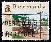 Postage stamp Bermuda 1987 Telephone Poles on Wagon — Stock Photo