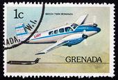 Postage stamp Grenada 1976 Beech Twin Bonanza, Airplane — Stock fotografie