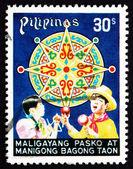 Frimärke filippinerna 1977 barn firar, jul — Stockfoto