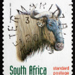 Постер, плакат: Postage stamp South Africa 1998 Blue Wildebeest