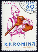 Postage stamp Romania 1961 Peasant Playing Bagpipe — Stock Photo