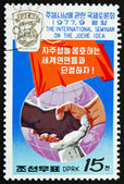 Postage stamp North Korea 1977 Joined Hands of Different Races — Stock Photo