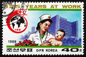 Postage stamp North Korea 1988 Doctor Examining Child — Stock Photo