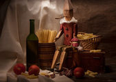 Vintage still life with spaghetti and Pinocchio — Стоковое фото