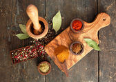 Spices and herbs on old wooden desk — Stok fotoğraf